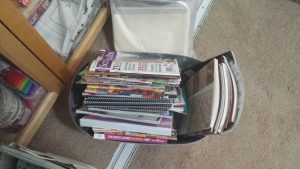 In front of my quilt fabric cabinet is this container of gathered books and magazines that need to be shelved.